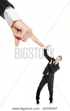 Scared young businessman afraid of big hand, isolated on white