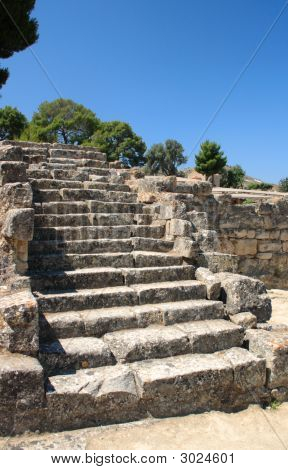 The ancient stone steps down into the marketplace or agora in the Minoan city of Phaistos (Festos) on Crete. poster