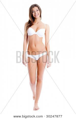 Full length portrait of a stunning young woman posing in bikini over white background