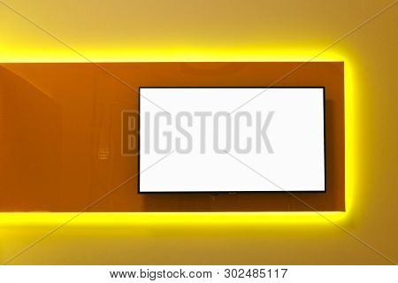 White Copy Space On The Tv Screen On The Wall. The Interior Design Of A Modern Room In The Style Of