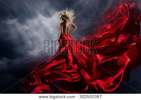 Woman In Red Dress Dance Over Storm Sky, Gown Fluttering Fabric Flying As Splash
