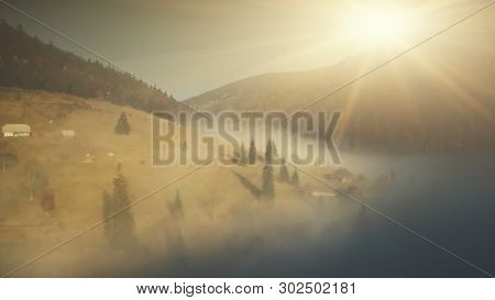 Mountain Slope Landscape Mist Weather Aerial View. Highland Scenery Wildlife Habitat Colorful Fir Forest Overview. Thick Foggy Canyon Sight Clean Ecology Concept Drone Flight