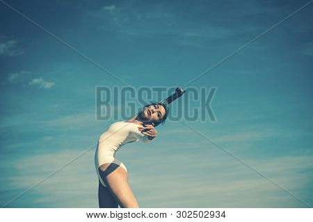 Athletic And Flexible. Concert Performance Dance. Young Ballerina Dancing On Blue Sky. Cute Ballet D