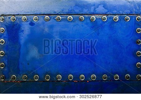 Industrial Background Texture With Blue Metal With Bolts And Rivets. Metal Plate Texture With Screws