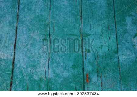 Green Wooden Texture From Wide Old Worn Planks In The Wall Of The Fence