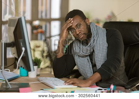 Stressed Out Professional Man Working In A Creative Office