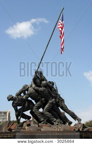 Statue memorial from the picture of the Marine Corps raising the flag on Iwo Jima. poster