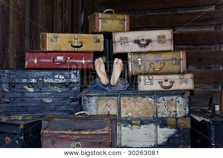 Suitcases And Feet
