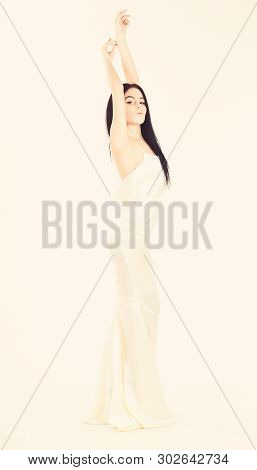 Bride, Girl In Graceful Dress. Woman In Elegant White Dress With Nude Back, White Background. Fashio