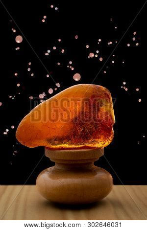One Piece Of Crazed Crack Red Yellow Amber Stone On Wooden Platform With Night Sky And Sky Lantern B
