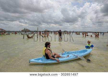 People Relaxing On Hammocks At Jericoacoara On Brazil