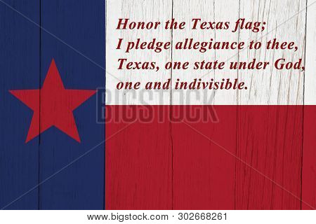 Pledge Of Allegiance  To The Texas State Flag On Weathered Wood