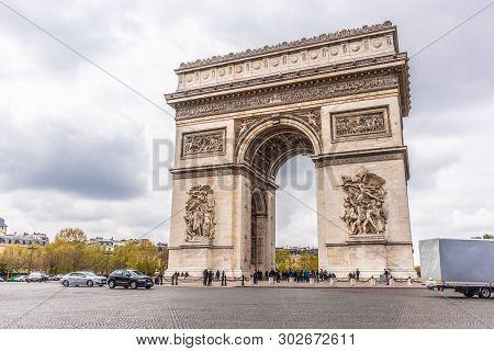 Paris, France - April 9, 2019: Champs-elysees And Arc De Triomphe On A Cloudy Day, Paris, France