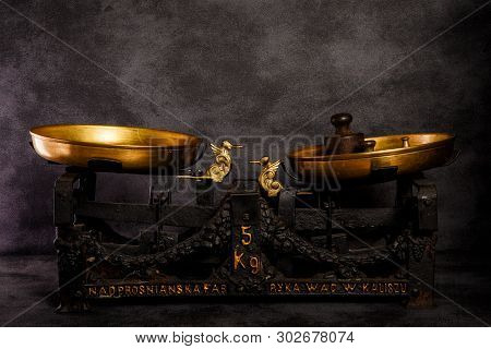 Antiquarian Scales With Two Golden Bowls And Old Weights