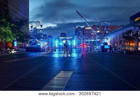 Montreal, Quebec, Canada, September 6, 2018: Place Des Arts Square Are, Night With Children And Pare