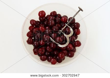 Fresh, Seedless Cherry Is Located In A Bowl On A White Background, Removal Of Bones From Cherries By