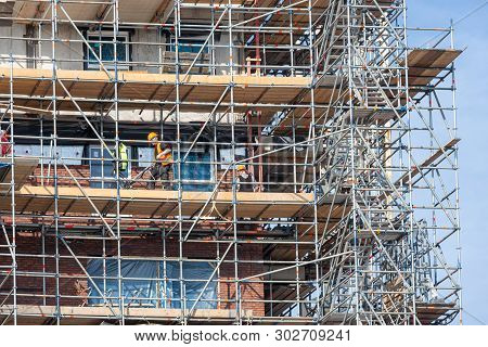 Lelystad, The Netherlands - April 5, 2019: Construction Site Of New Apartment Building With Scaffold