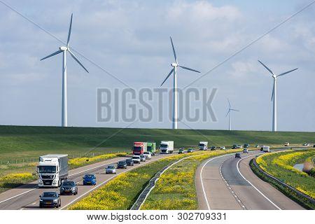 Lelystad, The Netherlands - April 5, 2019: Dutch Motorway A6 Near Lelystad With Wind Turbines And Bl