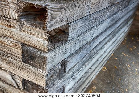 Abstract Stacked Wood Wall Corner On Dirt