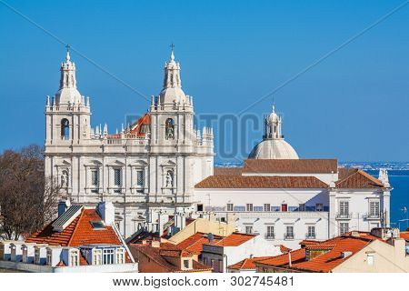 Lisbon, Portugal. Sao Vicente de Fora Monastery and dome of Panteao Nacional or National Panteon aka Santa Engracia Church seen from Sao Jorge Castle.