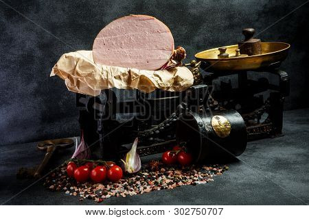 Big Piece Of Tasty Boiled Sausage On Piece Of Craft Paper