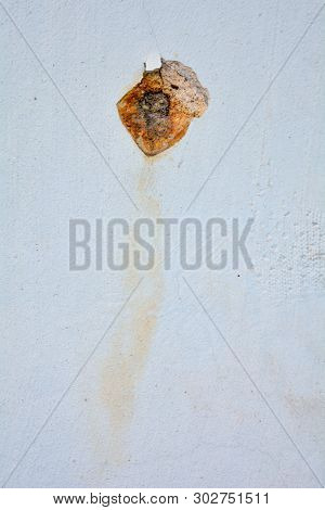 White Concrete Wall With Rusted Hole. Rust Big Dent On The Roughness Old House Wall
