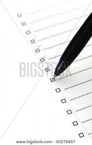 Checklist and pen closeup