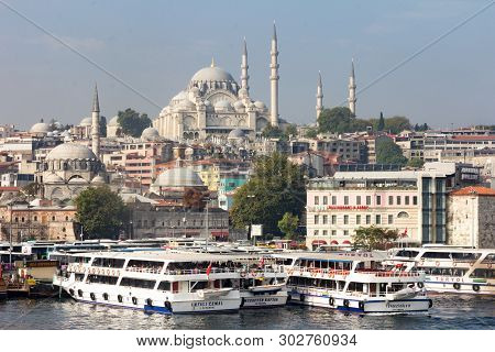 Istanbul, Turkey - September 21st 2015: Ferries And The Suleiman Mosque. Ferries Travel Between The