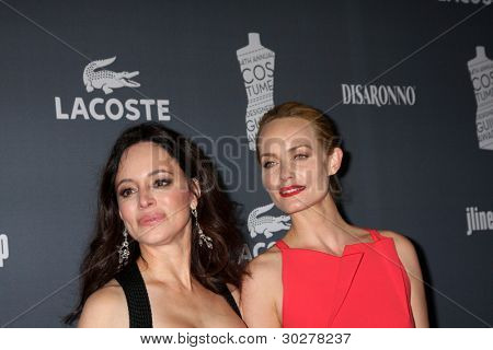 LOS ANGELES - FEB 21:  Madeleine Stowe, Amber Valletta arrive at the 14th Annual Costume Designers Guild Awards at the Beverly Hilton Hotel on February 21, 2012 in Beverly Hills, CA.