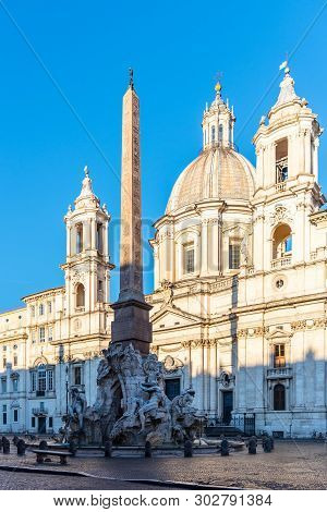 Four Rivers Fountain, Italian Fontana Dei Quattro Fiumi, With Obelisk And St Agnes Church On Backgro