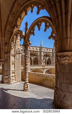 Lisbon, Portugal - June 30, 2018: Cloister of the Jeronimos Monastery or Abbey aka Santa Maria de Belem monastery. UNESCO World Heritage. Manuelino or Manueline