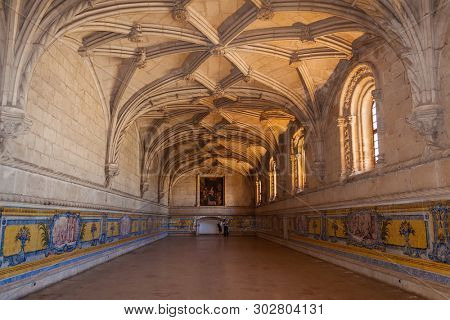 Lisbon, Portugal - June 30, 2018: Manuelino or Manueline Gothic Refectory of Jeronimos Monastery or Abbey aka Santa Maria de Belem. Ceiling with nervures or ribs and walls with tiles.
