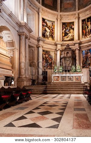 Lisbon, Portugal - June 30, 2018: Mannerist Main Chapel or Capela-Mor, Altar, Retable or Altarpiece and Tabernacle at Jeronimos Monastery or Abbey aka Santa Maria de Belem. UNESCO World Heritage Site.