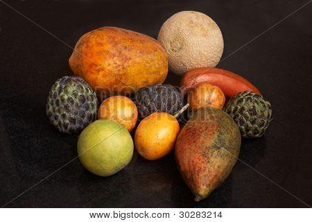 Mixed Exotic Ripe Fruit On Dark Surface