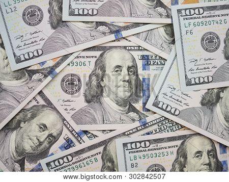 100 Dollar Bill Surrouded By New 100 Dollar Bills