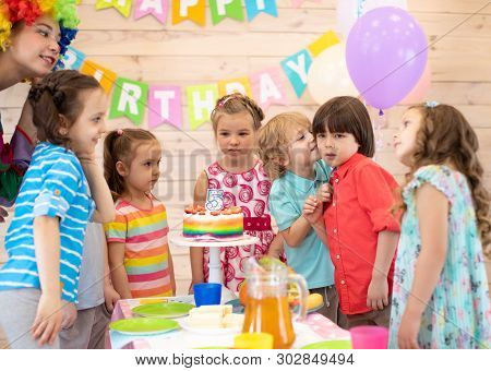 Group Of Children At Birthday Party. Cute Little Kid Congratulating Friend Birthday Boy
