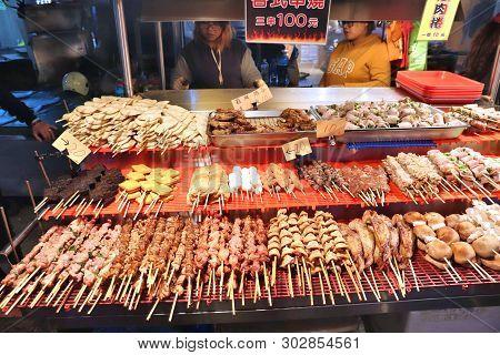 Keelung, Taiwan - November 22, 2018: Vendors Prepare Food At Famous Miaokou Night Market In Keelung,