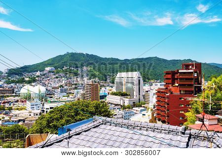 A Sunny Day In Nagasaki, Japan, With A View Over The Entire Center, Including The Hills.
