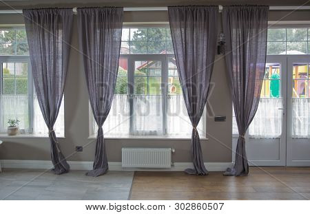New Modern Window With Curtains In Room .empty Curtain Interior In Bedroom With Sunlight .purple Cur