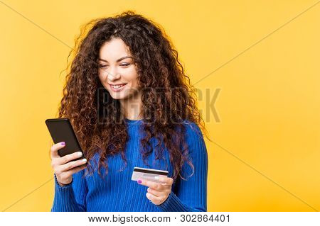 Beautiful Young Woman With Smartphone Credit Card. Online Shopping Transaction. Mobile Banking Urban