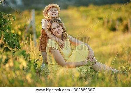 Happy Mother Hugged With Love By Daugther.