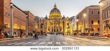 Vatican City By Night. Illuminated Dome Of St Peters Basilica And St Peters Square At The End Of Via