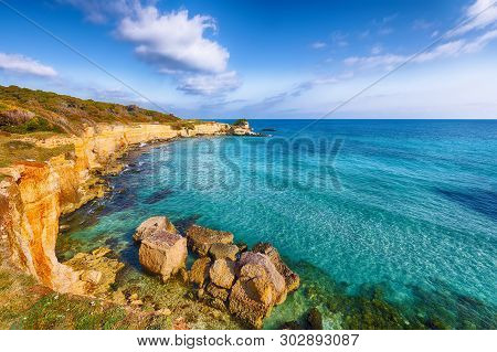 Picturesque Seascape With White Rocky Cliffs, Sea Bay, Islets And Faraglioni Near By Beach Spiaggia