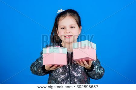 Choose One. Girl With Gift Boxes Blue Background. Black Friday. Shopping Day. Cute Child Carry Gift