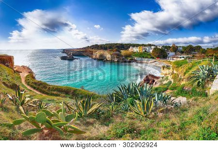 Beach Torre Sant'andrea And Islet Scoglio The Tafaluro