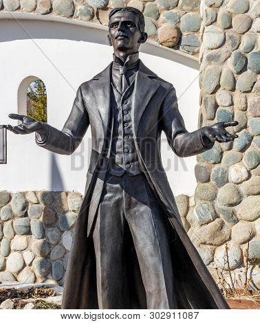 Kaluga Region, Russia - March 2019: Monument To Inventor And Scientist Nikola Tesla. Ethnographic Pa