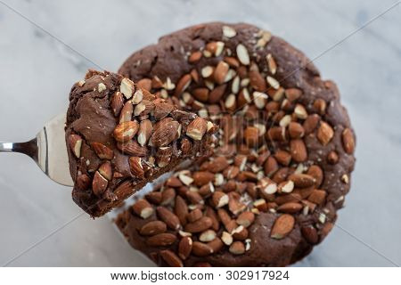 Piece Of Stack Homemade Dark Chocolate Brownies With Salted Almonds