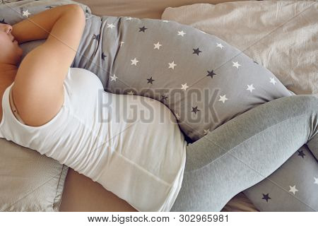Pregnant Woman Sleeping Using A Special Support Pillow Taken From Above In A Close Up Cropped View S