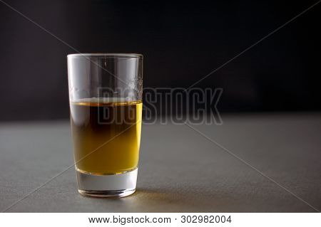 Glass Of Whiskey Or Cognac Or Alcohol Drink, Alcoholism And Alcohol Abuse Concept, Defocused, Select