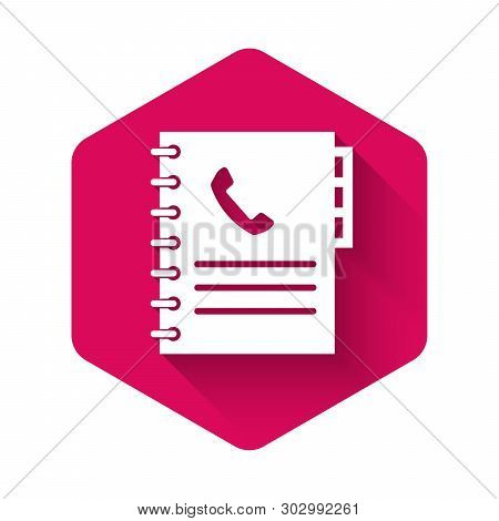White Phone book icon isolated with long shadow. Address book. Telephone directory. Pink hexagon button. Vector Illustration poster